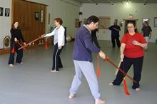 In the Kwoon, Introduction to T'ai Chi Straight Sword (March 2007): A handful of Water Tiger School students and one student from another South Shore program play Pushing Sword while McElroy Laoshi observes, comments, and gingerly walks through the moving drill.
