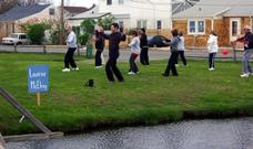World T'ai Chi & Qigong Day — Patchogue (April 26, 2008): With wind catching their wings, participants follow Laoshi Laurince McElroy (L) during his workshop on the Water Tiger favorite T'ai Chi Flying.