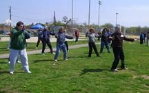World T'ai Chi & Qigong Day — Patchogue (April 26, 2008): Nancy Fiano (R), Dojo of the Dancing Dragon, leads while others follow through a mixture of Silk Reeling Exercises with a variety of Qigong.