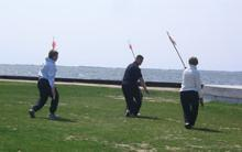 World T'ai Chi & Qigong Day — Patchogue (April 26, 2008): People seemed a little hesitant to play with long pointy objects for the workshop on the 16-posture Yang-style Spear Set facilitated by Sifu Michael Evans (center), Shaolin Kung-fu Studios.