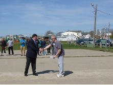 World T'ai Chi & Qigong Day — Patchogue (April 27, 2013): Edward P. Romaine, Town of Brookhaven Supervisor (L), presents Event Coordinator Laurince McElroy, of Water Tiger School of T'ai Chi Ch'uan in Patchogue (R), with both a letter-of-support from the Supervisor's Office and a proclamation from the Brookhaven Town Council celebrating the event's 13th year in the town. During the presentation, Mr. Romaine joked with the attendees about recognizing his own need to take up the arts of T'ai Chi and Qigong to help relieve the stress caused by his job.