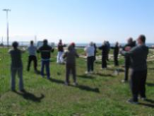 World T'ai Chi & Qigong Day — Patchogue (May 3, 2014): With Fire Island on the horizon behind, Ed Turney (C - wearing burgundy over white) Shaolin Kung Fu Studios in Rocky Point, presents an outlook on QingChengShan Daoist alchemical methods, unification of Kan and Li (water & fire) with excerpts from some of the Chinese classics.