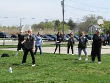 World T'ai Chi & Qigong Day; Shorefront Park, Patchogue NY (April 29, 2017): Laoshi Laurince McElroy (Front), Water Tiger School of T'ai Chi Ch'uan in Medford, introduces participants to the focus posture of his martial applications workshop: Wave Hands Like Clouds: A Portal to Self-Defense.