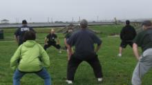 World T'ai Chi & Qigong Day; Shorefront Park, Patchogue NY (April 29, 2017): Laoshi Joel Valerio (Facing) of Ozone Park, presents Swing the Head and Sway the Tail during his workshop focusing on the most popular Qigong set in the world The Standing Eight Pieces of Brocade.