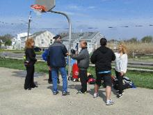 World T'ai Chi & Qigong Day; Shorefront Park, Patchogue NY (April 29, 2017):  Spencer Gee (C in grey jacket), Spencer Gee Wellness Corporation in Old Westbury, has been with us for 16 of our 17 years hosting the annual event. Every year he brings a different bag of toys for his T'ai Chi Workshop. This year's bag included striking pads (as seen here) and a carriage whip!