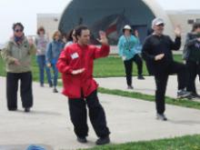 "World T'ai Chi & Qigong Day; Shorefront Park, Patchogue NY (April 29, 2017):  Joseph Panico (C in red), West Babylon, was the ""newest kid on the block"" this year as he joined us for his third year. Here he is introducing participants to the details of his lineage's 24-Posture Form."